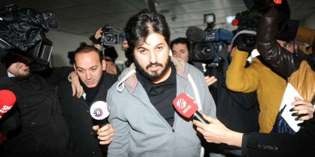 Detained businessman Reza Zarrab (C) is surrounded by journalists as he arrives at a police center in Istanbul on December 17 ,2013. Turkish police detained more than 20 people including the sons of three cabinet ministers and several high-profile businessmen on December 17 in a probe into alleged bribery and corruption, local media reported. Prime Minister Recep Tayyip Erdogan's ruling Justice and Development Party (AKP), which boasts of being pro-business, has pledged to root out corruption, a chronic problem in Turkey. AFP PHOTO / OZAN KOSE (Photo credit should read OZAN KOSE/AFP/Getty Images)