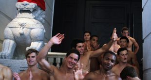 A group of topless male models waves to a crowd of onlookers outside the soon to open Abercrombie & Fitch flagship clothing store in Hong Kong on August 5, 2012. The store is due to be opened for trading on August 11.    AFP PHOTO / LAURENT FIEVET        (Photo credit should read LAURENT FIEVET/AFP/GettyImages)