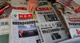 Chinese news papers showing U.S. President Donald J. Trump at a newsstand in Shanghai, China January 21, 2017. REUTERS/Aly Song